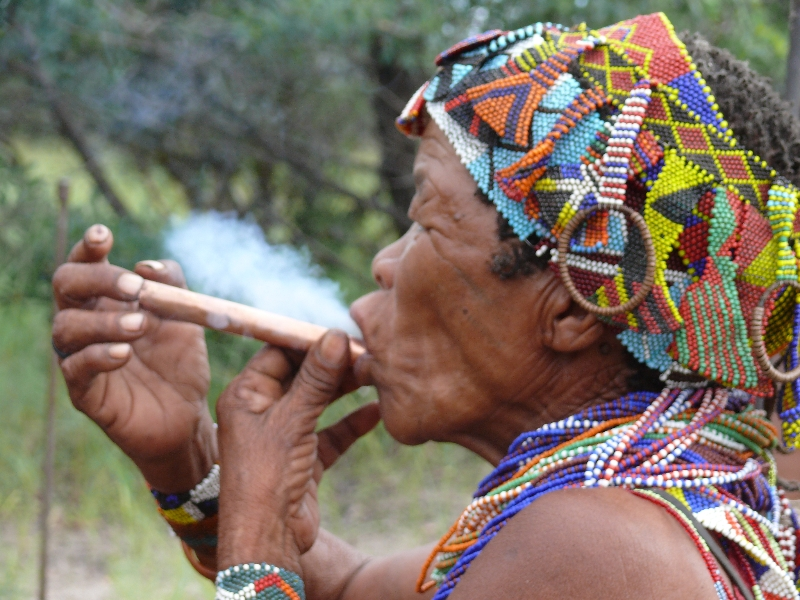 namibia-country-lodges-activity-smoking-pipe-by-women